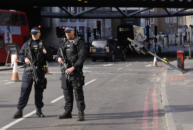 Two armed police guard an area near Borough Market in the London Bridge area of London, on Monday, June 5, 2017. Photo: AP