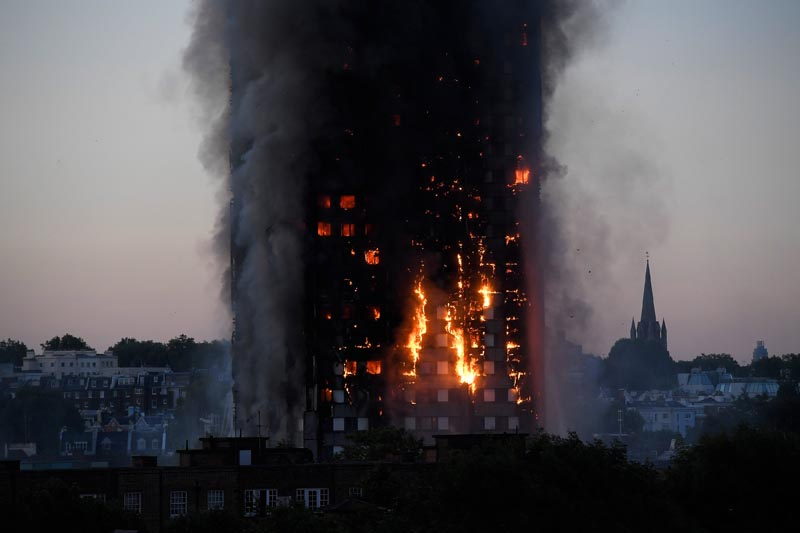 Flames and smoke billow as firefighters deal with a serious fire in a tower block at Latimer Road in West London, Britain, on June 14, 2017. Photo: Reuters
