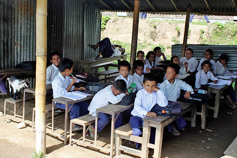 Students are compelled to attend their class at a makeshift classroom in Sulikot Rural Municipality in Gorkha district, on Tuesday, June 20, 2017. Photo: RSS
