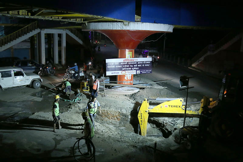 An excavator being used to install drinking water pipes under the Melamchi Drinking Water Project at Jamal of Kathmandu, on Sunday, June 4, 2017. Photo: RSS