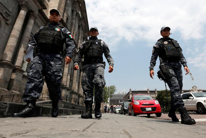 Police officers walk on the main square a day after local election in Toluca, Mexico, on June 5, 2017. Photo: Reuters