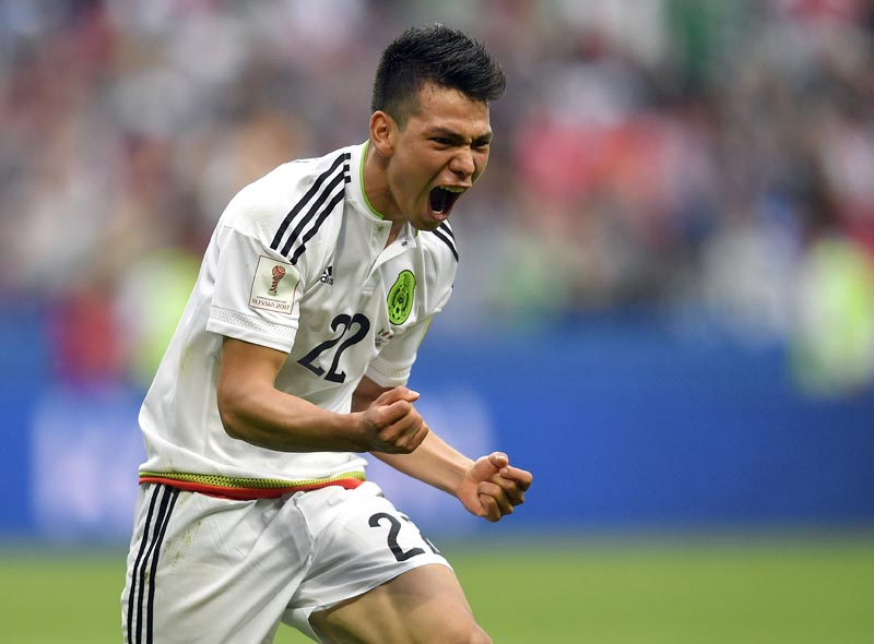 Mexico's Hirving Lozano celebrates after scoring his side's second goal during the Confederations Cup, Group A soccer match between Mexico and Russia, at the Kazan Arena, Russia, on Saturday, June 24, 2017. Photo: AP