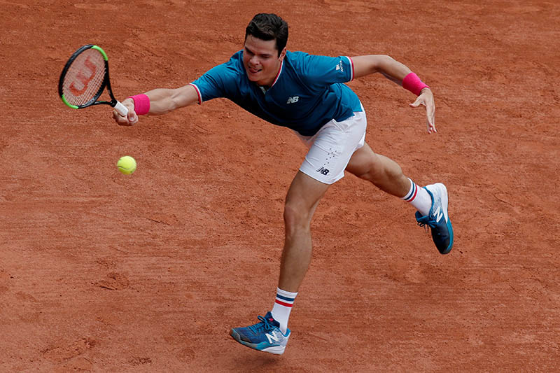 Canada's Milos Raonic in action during his third round match against Spain's Guillermo Garcia-Lopez. Photo: Reuters