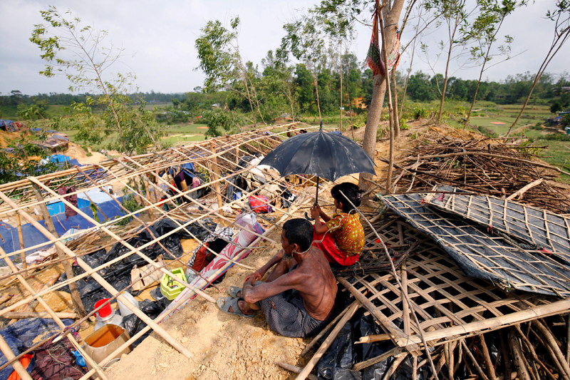 Rohingya refugees sit in front of their house which has been destroyed by Cyclone Mora at the Balukhali Makeshift Refugee Camp in Coxu2019s Bazar, Bangladesh May 31, 2017. Photo: REUTERS