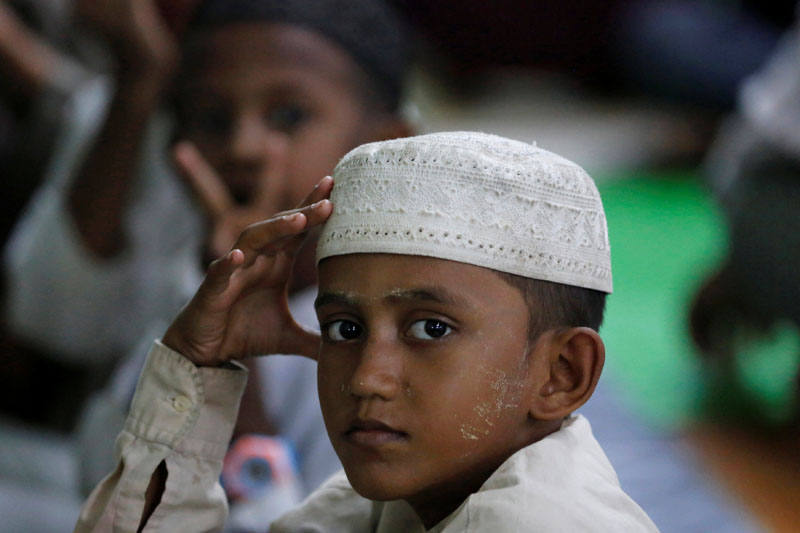 A Muslim boy sits during prayers in a mosque in Yangon of Myanmar, on June 7, 2017. Photo: Reuters