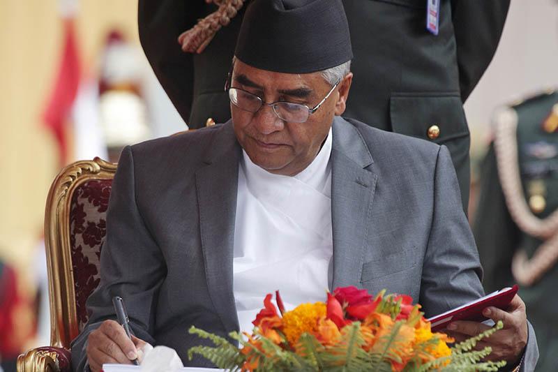 PM elect Sher Bahadur Deuba signs after taking the oth of office and secrecy from President Bidya Devi Bhandari in Sheetal Niwas, Kathmandu, on Wednesday, June 7, 2017. Photo: RSS