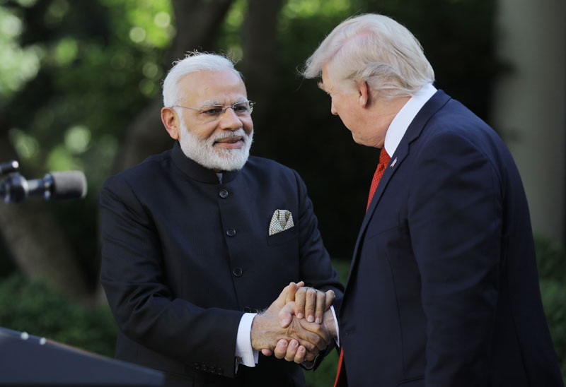 US President Donald Trump (right) greets Indian Prime Minister Narendra Modi during their joint news conference in the Rose Garden of the White House in Washington, US, on June 26, 2017. Photo: Reuters