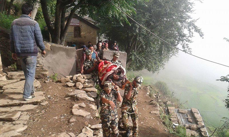 Nepai Army personnel, deployed for poll duty, taking a woman in labour from Pandavgufa Rural Municipality to Nepalgunj for delivery, in Bajura, on Sunday, June 25, 2017. Photo: THT