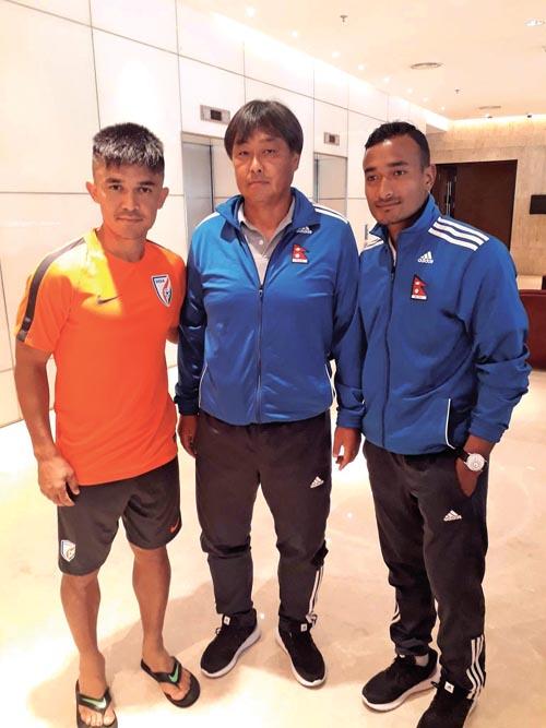(From left) India skipper Sunil Chhetri, Nepal national football team coach Gyotoku Koji and captain Biraj Maharjan pose for a photo in Mumbai , on Monday. Photo Courtesy: NSJF