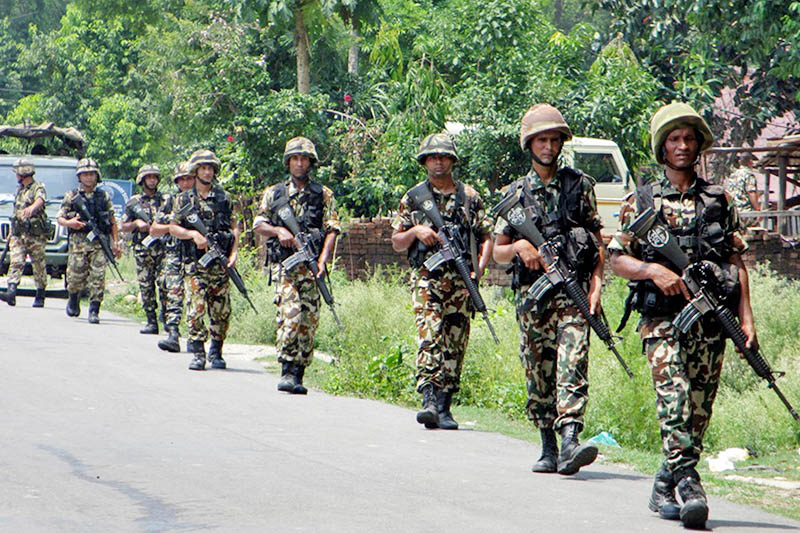 As the second round of local polls is around the corner, Nepali Army personnel are seen patrolling along the East-West Highway in Mahendra Nagar of Kanchanpur district, on Monday, June 19, 2017. Photo: RSS