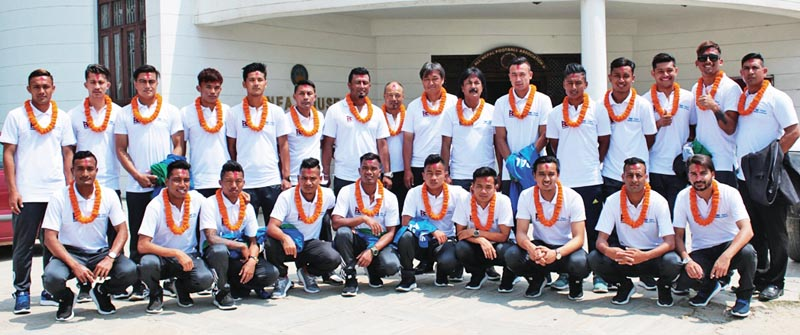 Nepal national football team members pose for group photo before their departure to India to play a friendly match, in Lalitpur, on Sunday. Photo: THT