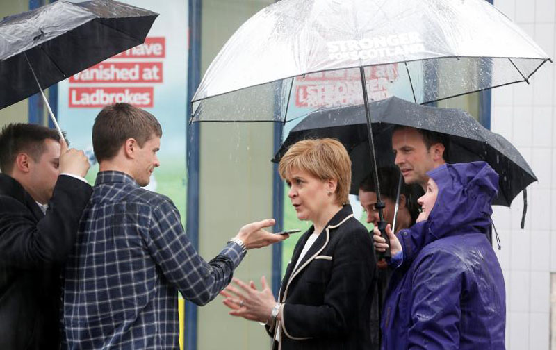 Scotland's First Minister Nicola Sturgeon speaks to a man as she campaigns in Lundin, Fife, Scotland, Britain, on June 5, 2017. Photo: Reuters