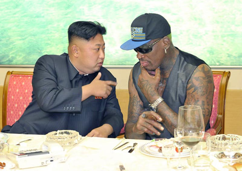 In this undated photo published on September 7, 2013, on the homepage of North Korea's Rodong Sinmun newspaper, North Korean leader Kim Jong Un, (left), talks with former NBA player Dennis Rodman during a dinner in North Korea. Photo: Rodong Sinmun/Korea News Service via AP