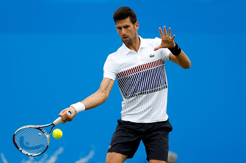 Serbia's Novak Djokovic in action during his second round match against Canada's Vasek Pospisil. Photo: Reuters