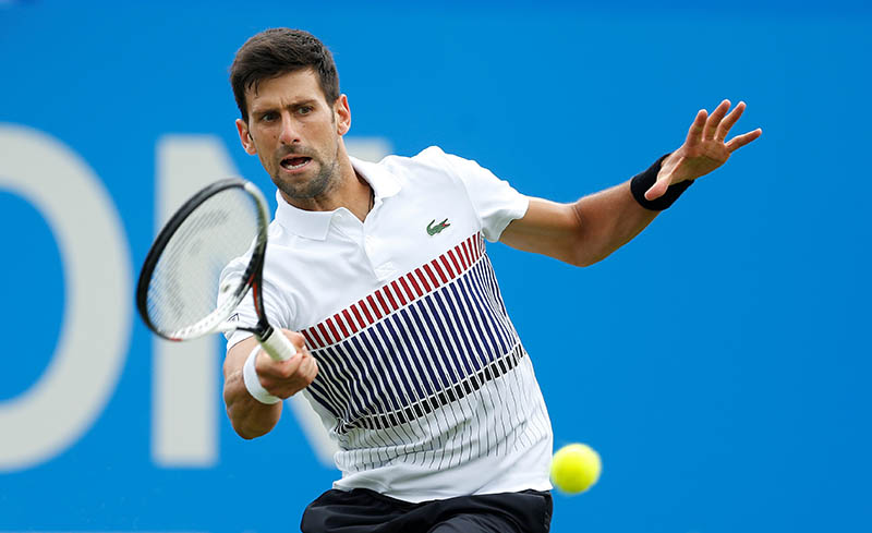 Serbia's Novak Djokovic in action during his quarter final match against USA's Donald Young. Photo: Reuters