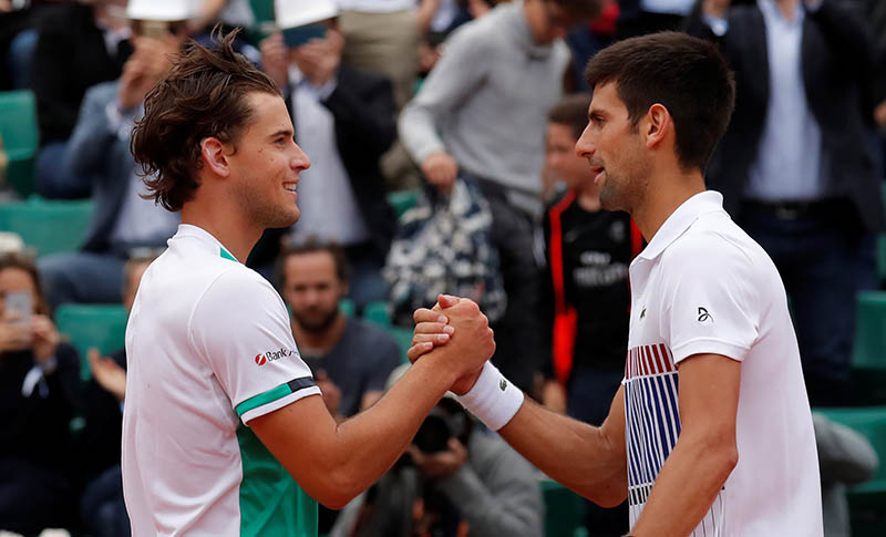 Austria's Dominic Thiem shakes hands with Serbia's Novak Djokovic after winning their quarter final match. Photo: Reuters
