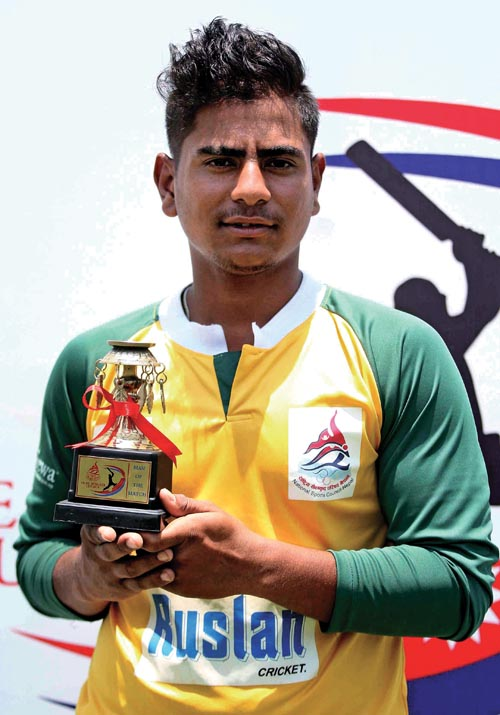 Bipin Khatri of Western Region holds man-of-the-match trophy after the first Prime Minister Cup match against Mid-western Region in Kathmandu on Thursday. Photo: Udipt Singh Chhetry/ THT