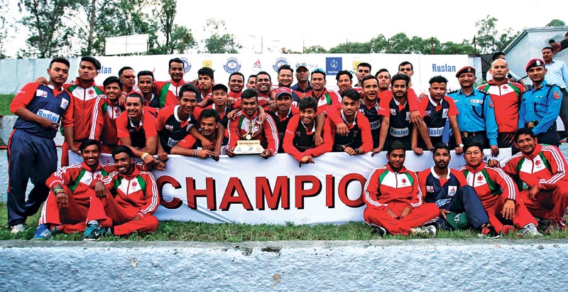 Players and officials of Tribhuvan Army Club and Nepal Police Club pose for a group photo after the first PM Cup One-day Nationanl Menu0092s Cricket Tournament, at the TU Stadium in Kathmandu, on Thursday. Photo: Uditp Singh Chhetry/ THT