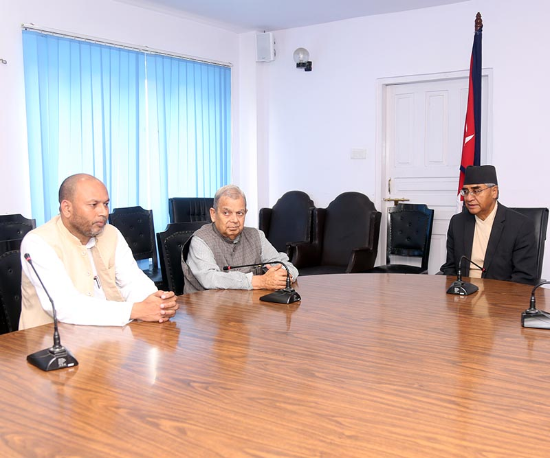 Rastriya Janata Party-Nepal Chair Mahantha Thakur (centre) and leader Anil Kumar Jha (left)  meeting with Prime Minister Sher Bahadur Deuba at the latter's office in Singhadurbar, Kathmandu, on Wednesday, June 21, 2017. Photo: RSS