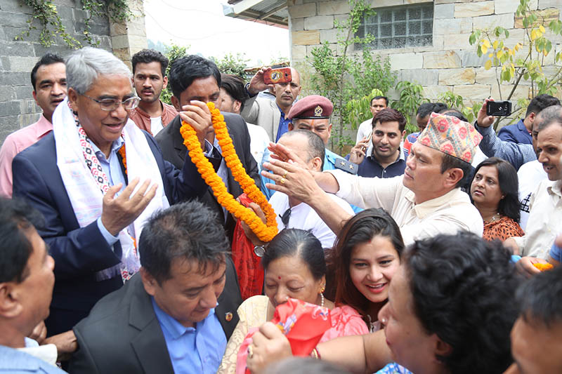 Local peole and NC cadres throng Sher Bahadur Deuba's residence in Budanilakhanta to congratulate him after being elected as the PM of Nepal, on Wednesday, June 7, 2017. Photo: RSS