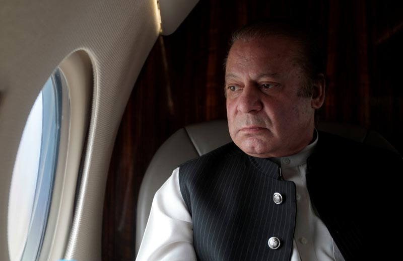 Pakistani Prime Minister Nawaz Sharif looks out the window of his plane after attending a ceremony to inaugurate the M9 motorway between Karachi and Hyderabad, Pakistan, on February 3, 2017. Photo: Reuters