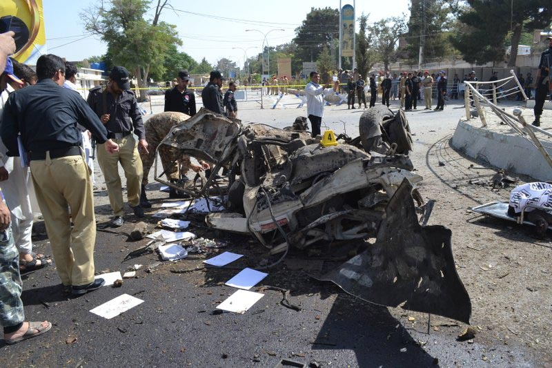 Pakistani police officers examine the site of an explosion in Quetta, Pakistan, on Friday, June 23, 2017.