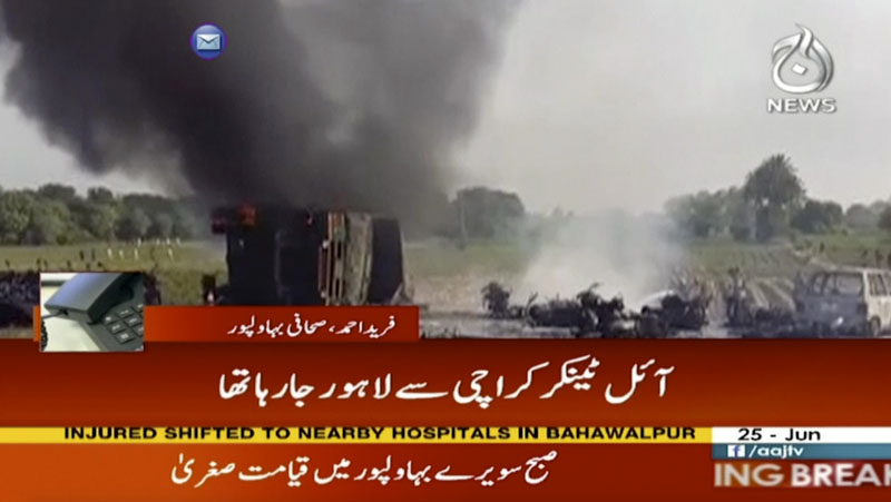 In this image taken from video, black smoke rises from oil tanker on road in Bahawalpur, Pakistan, on Sunday, June 25, 2017.  An overturned oil tanker burst into flames in Pakistan on Sunday, killing people who had rushed to the scene of the highway accident to gather leaking fuel, an official said. Photo: AAJ News via AP