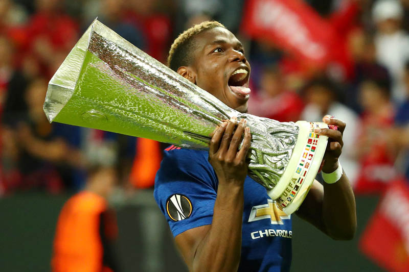 Manchester United's Paul Pogba celebrates with the trophy after winning the Europa League. Photo: Reuters