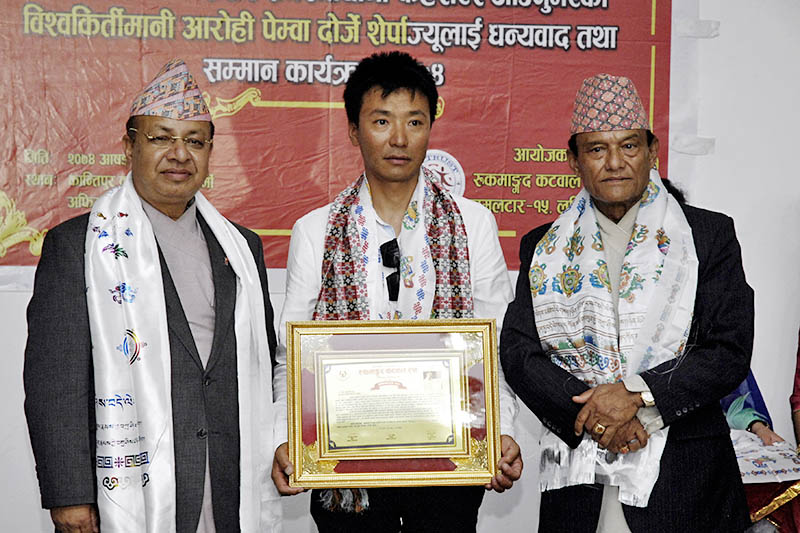 Climber Pemba Dorje Sherpa pose for a portrait with CoAS Rajendra Chhetri and former Army chief Rukmangad Katwal after being felicited in a programme organised by Rukmangad Katwal Trust in Kathmandu, on Monday, June 26, 2017. Photo: Naresh Shrestha
