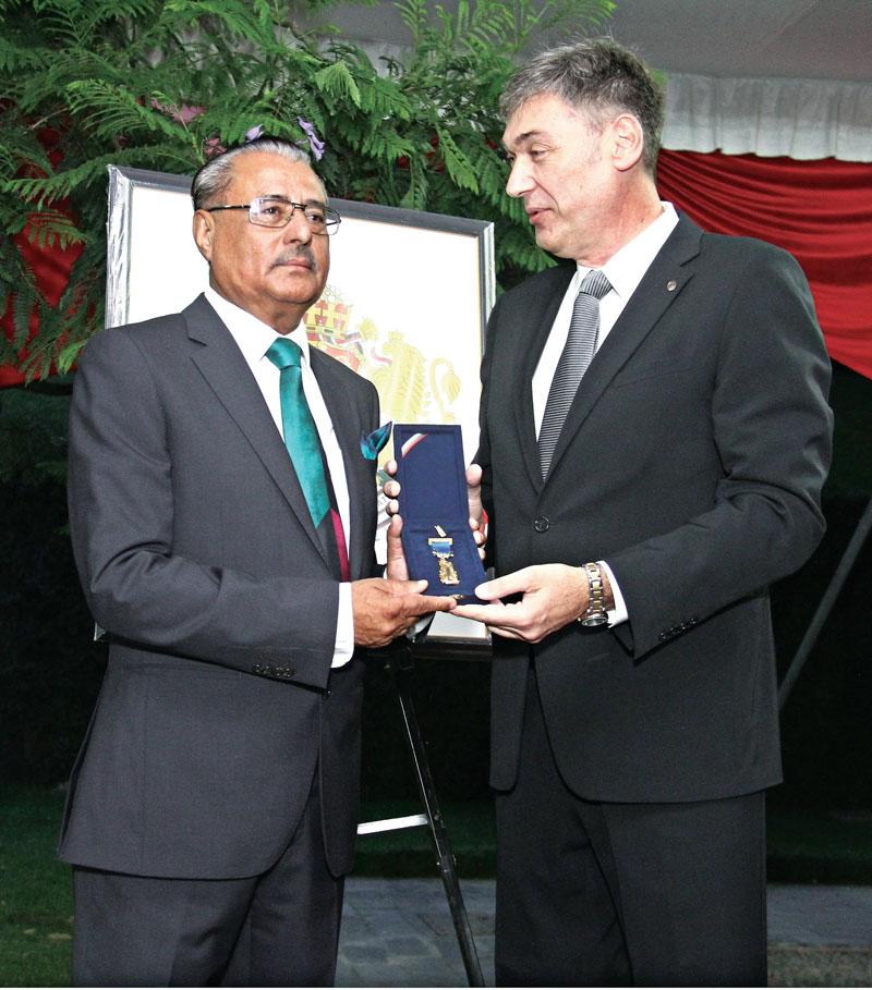 Bulgarian Ambassador to Nepal Petko Doykov, honours Bhola Bikram Thapa, honorary nconsul for the Republic of Bulgaria in Nepal, on Wednesday, June 21, 2017. Photo: THT