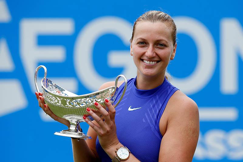 Czech Republic's Petra Kvitova celebrates with the trophy. Photo: Reuters