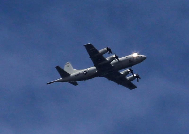 A US P3 Orion surveillance aircraft is seen flying over the town of Marawi city, as government troops continue their assault against insurgents from the Maute group, who has taken over large parts of the city, Philippines, on June 9, 2017. Photo: Reuters