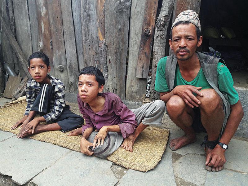 Dhan Bahadur Tamang (right) with his disabled sons in Gaurishankar Rural Municipality, on Friday, June 10, 2017. Photo: THT