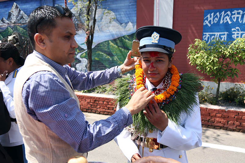 A newly graduated police officer being congratulated by her guardian in Kathmandu, on Friday, June 2, 2017. Photo: RSS