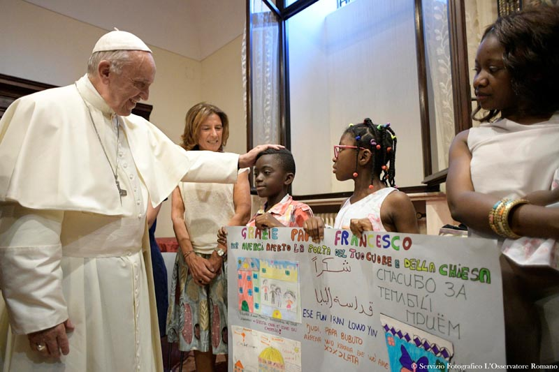 Pope Francis meets a group of refugees during a conference on families and adolescent education at Rome's Basilica of St. John in Lateran, Italy, on June 19, 2017. Photo: Osservatore Romano/Handout via Reuters