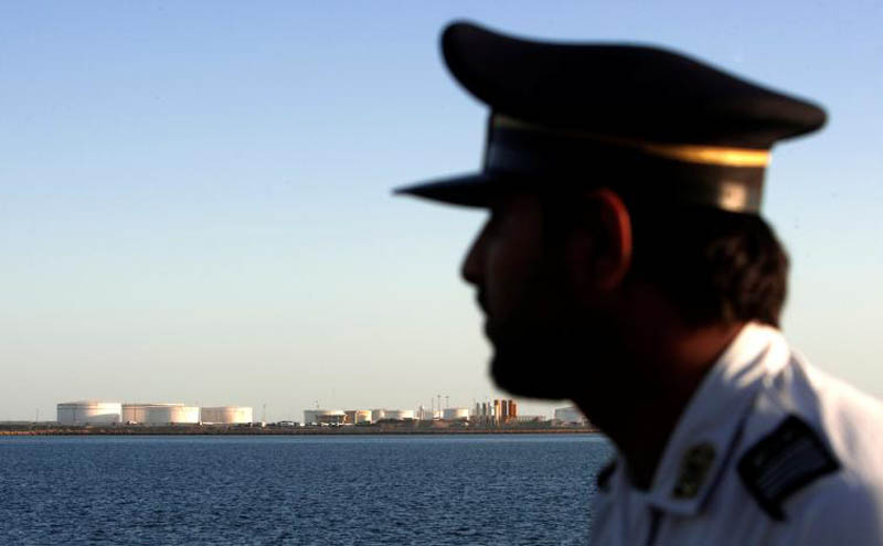 A security personnel looks on at oil docks at the port of Kalantari in the city of Chabahar, 300km (186 miles) east of the Strait of Hormuz, Iran, on January 17, 2012. Photo: Reuters