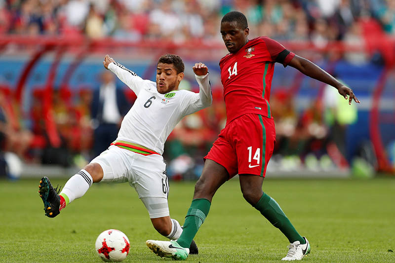 Portugalu2019s William Carvalho in action with Mexicou2019s Jonathan Dos Santos. Photo: Reuters
