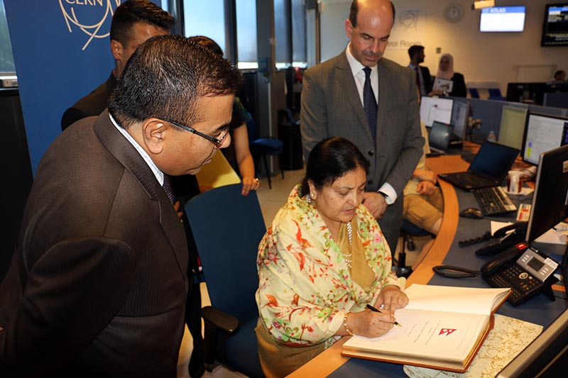 President Bidya Devi Bhandari (centre) signing a visitor book while visiting CERN, the European Organization for Nuclear Research, physicists and engineers, in Switzerland, on Friday, June 16, 2017. Photo: RSS