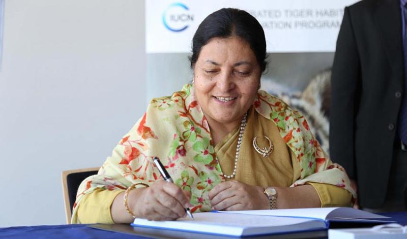 President Bidya Devi Bhandari signing the IUCN guest book during her visit to IUCN Headquarters in Gland, Switzerland, on Friday, June 16, 2017. Photo courtesy: IUCN/Mark Gnadt