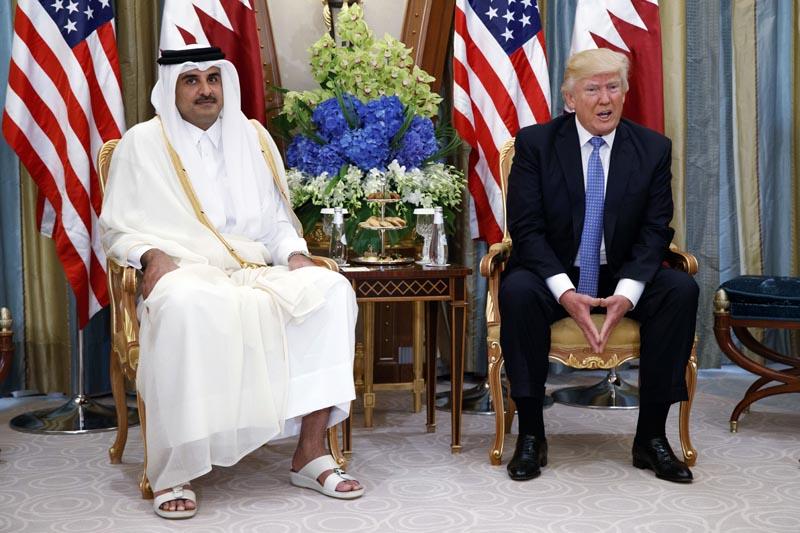 President Donald Trump, right, holds a bilateral meeting with Qatar's Emir Sheikh Tamim Bin Hamad Al Thani, in Riyadh, Saudi Arabia, on May 21, 2017. Photo: AP