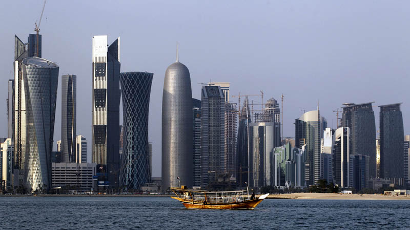 FILE - In this Thursday January 6, 2011 file photo, a traditional dhow floats in the Corniche Bay of Doha, Qatar, with tall buildings of the financial district in the background. Photo: AP