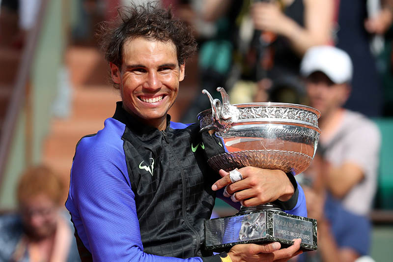 Spain's Rafael Nadal celebrates with the trophy after winning the final against Switzerland's Stan Wawrinka. Photo: Reuters   Reuters / Pascal Rossignol