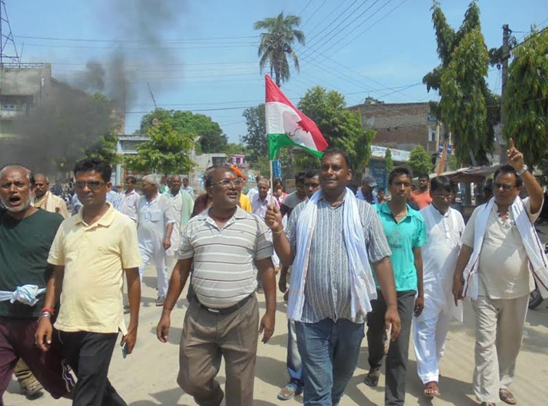 Rastriya Janata Party-Nepal cadres taking out a rally during Madhes, Tharuhat and Limbuwan bandh in Rajbiraj; security personnel watching  a bonfire lit by enforcers of the general strike in Rautahat, on Tuesday, June 13, 2017. Photo: THT