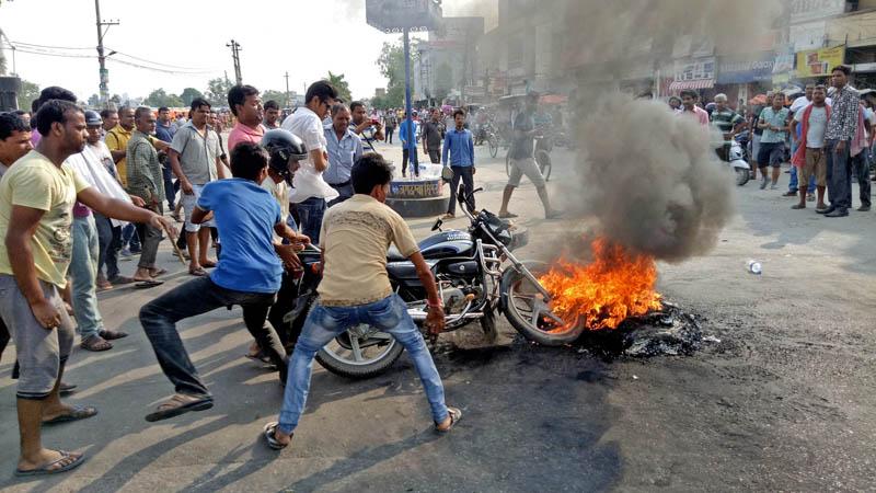 The cadres of Rastriya Janata Party Nepal set ablaze a motorcycle in Birgunj, on Wednesday, June 14, 2017. Photo: Ram Sarraf