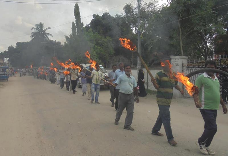 Leaders and cadres of Rastriya Janata Party-Nepal taking out a torch rally as part of the partyu2019s protest programme, in Gaur, Rautahat, on Monday, June 12, 2017. Photo: THT