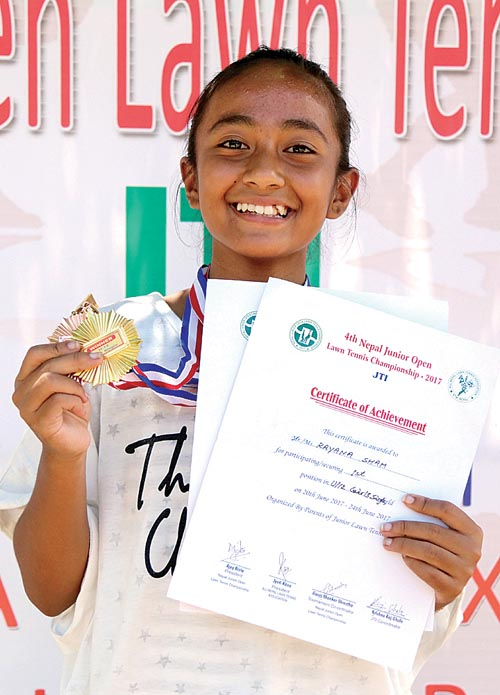 Rayana Shah displays the medal after winning the U-12 girlsu0092 singles title of the fourth Nepal Junior Open Lawn Tennis Championship in Lalitpur, on Saturday. Photo: THT