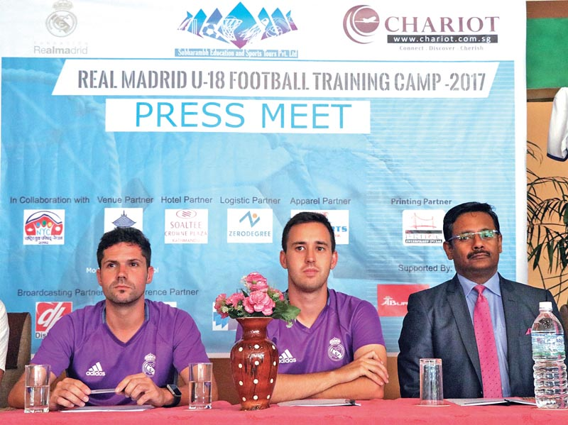 (From left) Real Madrid Foundation coaches Rafael Palacios and Daniel Landaburu Rotella with General Manager of Soaltee Crowne Plaza Upaul Majumdar at a press meet in Lalitpur, on Sunday. Photo: THT