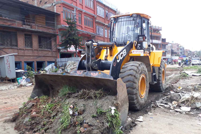 A bull dozer being used for road expansion along the Suryabinayak-Jagati road section in Bhaktapur, on Tuesday, June 27, 2017. Photo: RSS