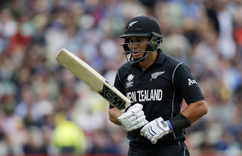 New Zealand's Ross Taylor walks off after losing his wicket. Photo: Reuters