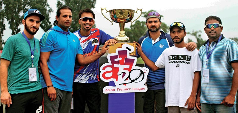 Skippers and representatives of the six franchise-based teams pose for a group photo with the trophy during the opening ceremony of the Asian Club Premier League at the TU Stadium in Kathmandu, on Monday. Photo: Udipt Singh Chhetry/ THT